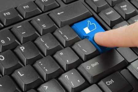 Finger pushing social media keyboard button Stock Photo - 14085811