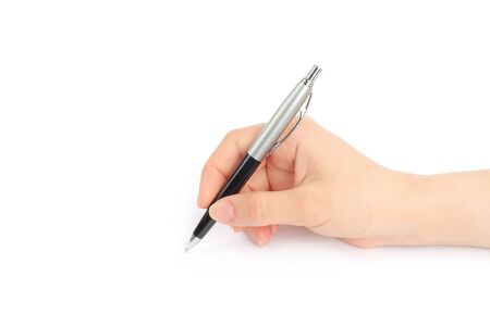 Hand with pen on white background  photo