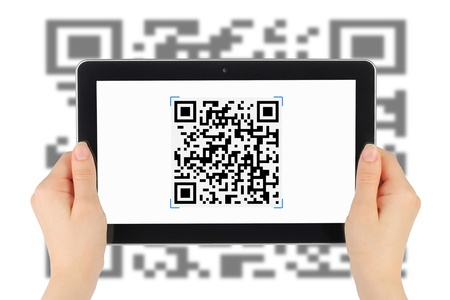 Scanning of QR code by tablet pc photo