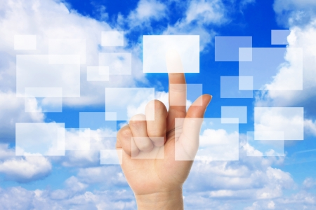 thinking cloud: Cloud computing concept with woman hand on blue sky background