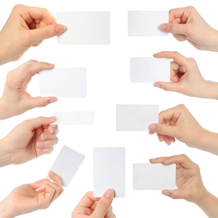 index card: Hands hold business cards on white background