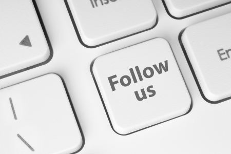 Follow us button on keyboard background Stock Photo - 14967326