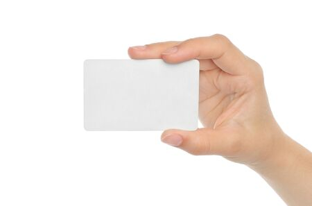 index card: Hand holds business card on white background Stock Photo