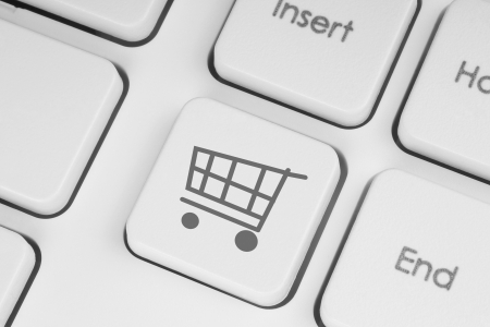 Shopping cart icon on keyboard key close-up photo
