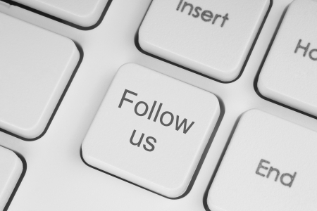 follow us: Follow us button on keyboard background