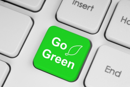 Go green button on keyboard background  photo
