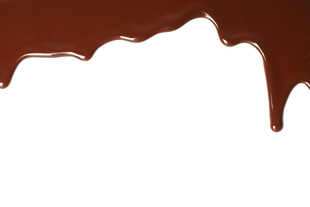 Melted chocolate dripping on white background photo