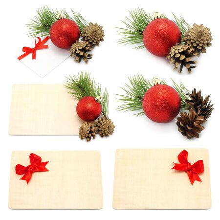 Set of Christmas compositions with balls and boards on white background photo