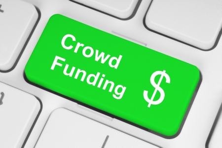 financing: Green crowd funding button on keyboard