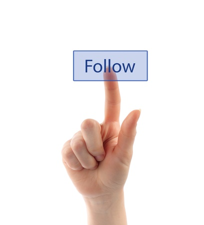 Hand pressing follow button on white background photo