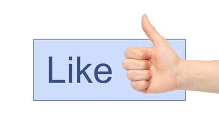 Like button with woman hand on white background Stock Photo - 16828820