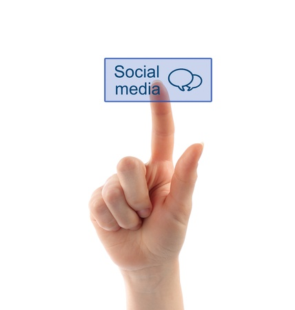 Hand pressing social media button on white background photo
