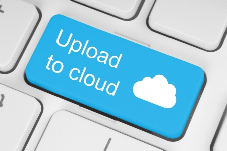 command button: Upload to cloud concept on blue keyboard button