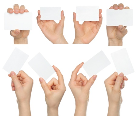 Hands hold business cards collage on white background   photo