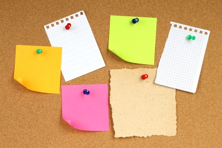 cork sheet: Color notes papers on wooden background  Stock Photo