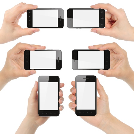 using phone: Hands holding smart phones isolated on white background Stock Photo