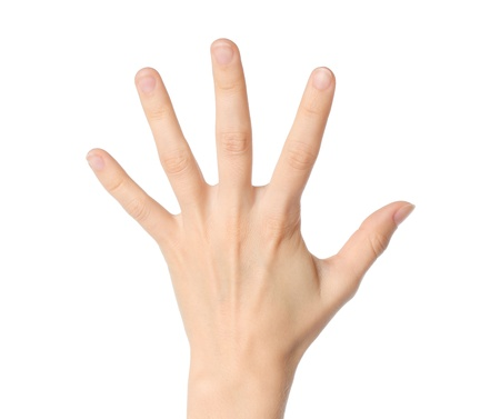 Woman hand showing five fingers on white background  photo