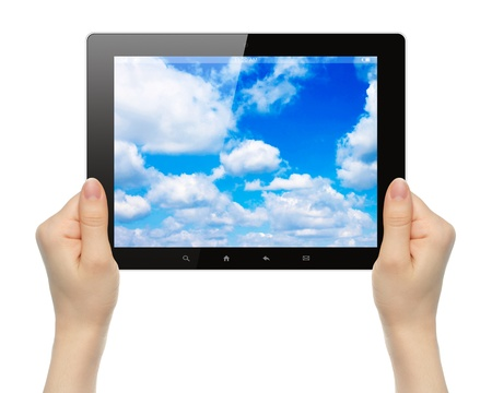 Woman hands holding tablet PC with sky on white background