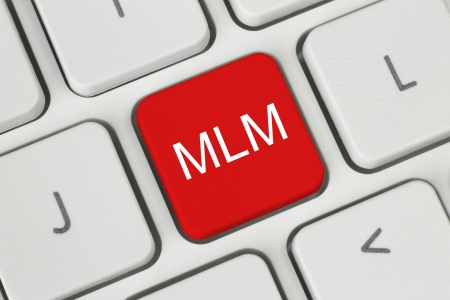 Red MLM  Multi Level Marketing  button on keyboard close-up  photo