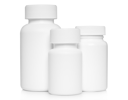 White medical containers on white background  Stock Photo