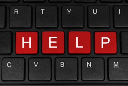 computer support: The word help made of four red buttons of a black keyboard close-up