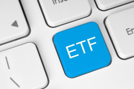 traded: ETF (Exchange Traded Fund) blue button on white keyboard close-up  Stock Photo