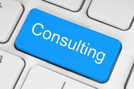 Blue consulting button on white keyboard  photo