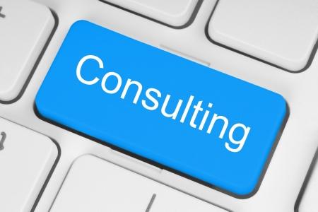 botão azul consultoria no teclado branco Imagens