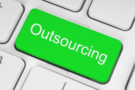 Green outsourcing button on white keyboard  Imagens