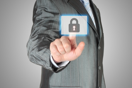 Businessman pushing virtual security button on grey background