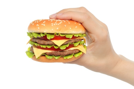 Hand holds big hamburger on white background close-up  photo