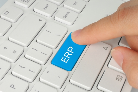 Hand pushing blue ERP  enterprise resource planning  button on white keyboard background
