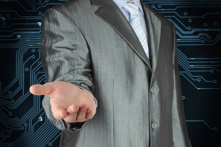 Businessman with empty hand on circuit board background  photo