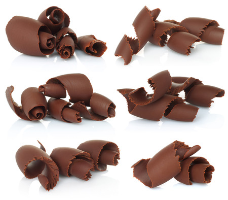 Chocolate shavings set on white background   Imagens