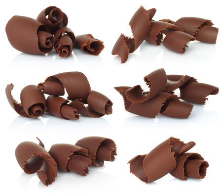 Raspas de chocolate definidos no fundo branco Imagens