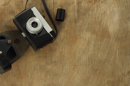 Old camera on wooden background  photo
