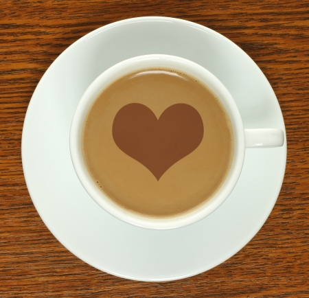 Coffee cup with heart on a wooden background   photo
