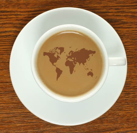 Coffee cup with map on a wooden background   photo