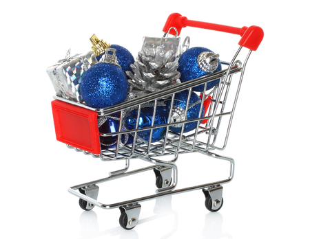 Shopping cart with Christmas gifts on white background  photo