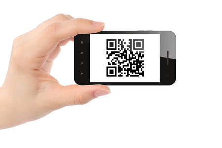 Hand holds smart phone with QR code