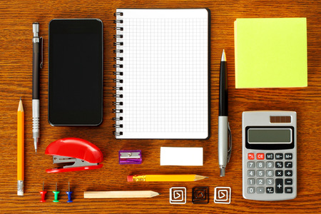 Work place with office stationery close-up photo