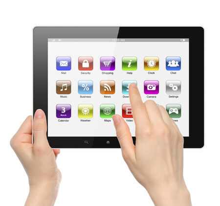 Woman hands hold and touch icon on tablet PC on white background   photo