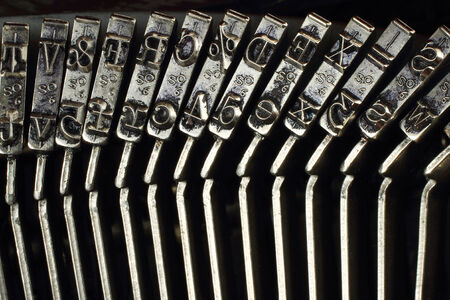 key words art: Close-up of mechanism of typing machine, metal letters