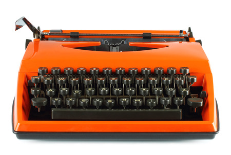 Vintage typing machine on white background   photo