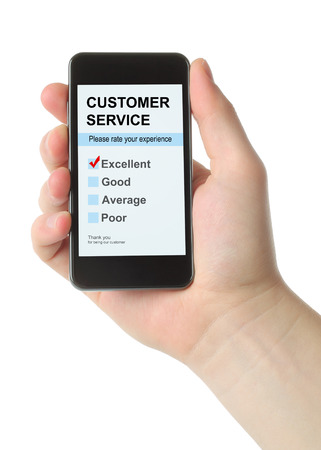 Man hand holds smart phone with customer service satisfaction survey on white background  photo