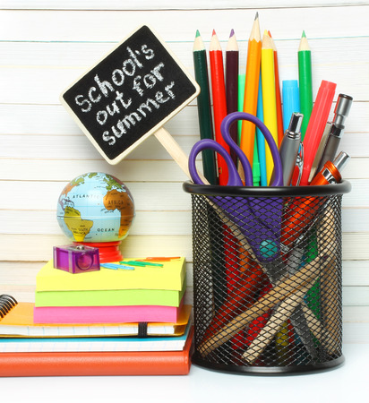 School-office stationery on book background   photo