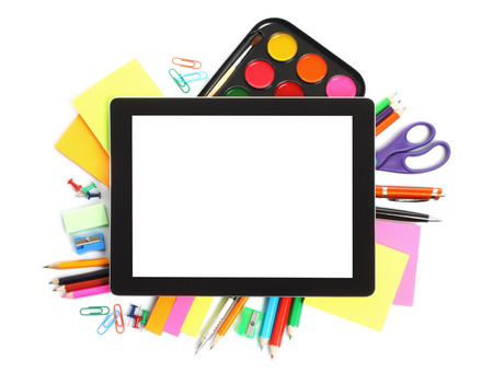 Tablet PC with school office supplies on white background  Stock Photo