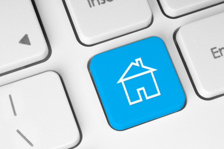 home security system: Blue button with house on computer keyboard background Stock Photo