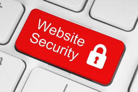 Red website security button on white keyboard background photo
