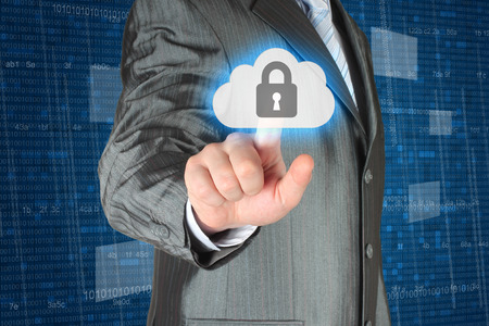 data protection: Businessman pushing virtual cloud security button on digital background   Stock Photo